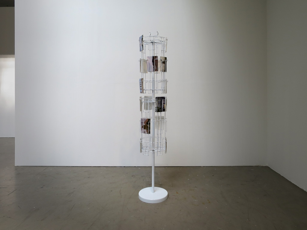 Claude Closky, '5 continents', 2012, five windows, five postcard stands 170 x 30 x 30 cm, postcards, offset print on 350 g. card 10,5 x 15 cm, installation, dimensions variable. Exhibition view 'Invitation au voyage', Centrale for contemporary art, Brussels. 23 April - 30 August 2015. Curated by Alfred Pacquement
